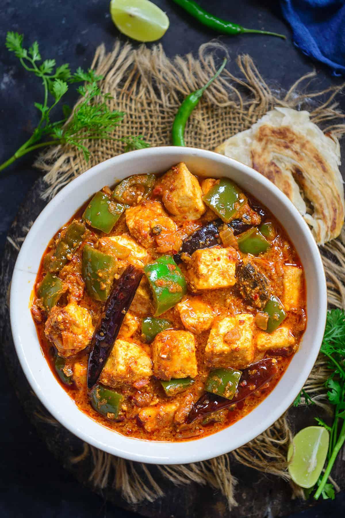 Kadai Paneer served in a bowl.