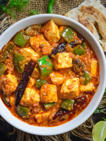 Kadai Paneer or Karahi Paneer is a famous Paneer gravy recipe and is one of the most common dishes ordered in a restaurant. It is spicy and delicious and is best paired with Lachha Paratha or Naan. I have a secret technique to make this dish just like your fav restaurant or Dhaba.