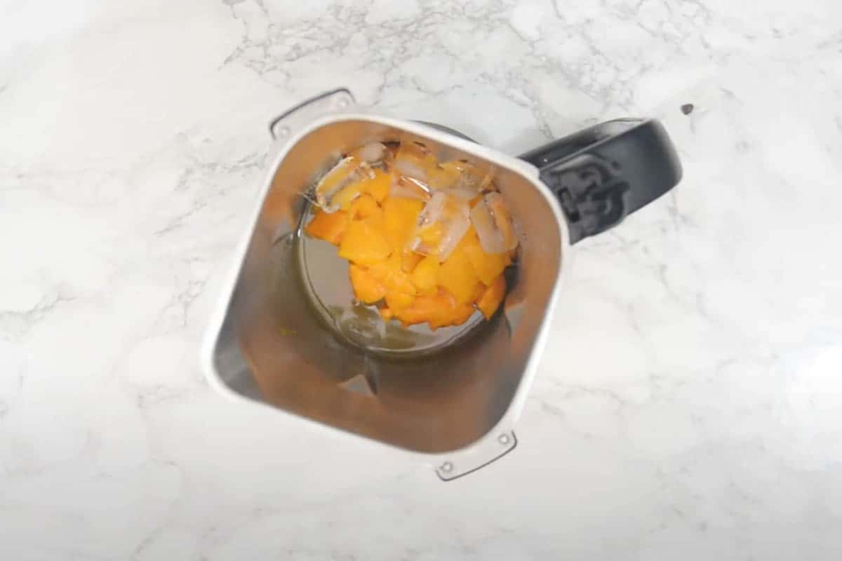 All the ingredients added to a blender.