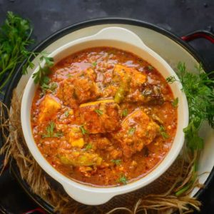 Paneer Masala is an easy to make dish of paneer where paneer cubes are simmered in an onion tomato based spicy gravy. It can be paired with Indian bread or Jeera Rice. Here is how to make Paneer Masala Gravy at home.