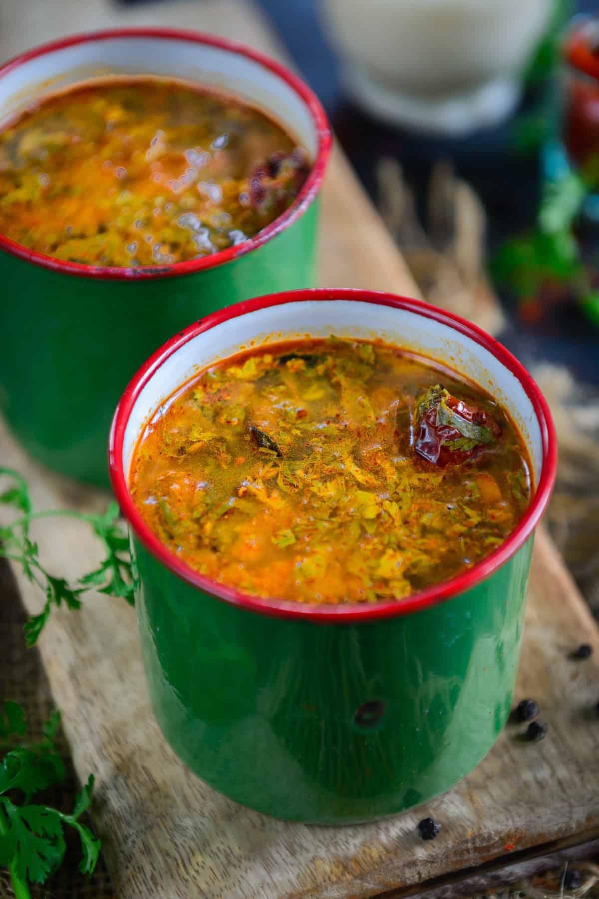 Pepper Rasam served in a glass.