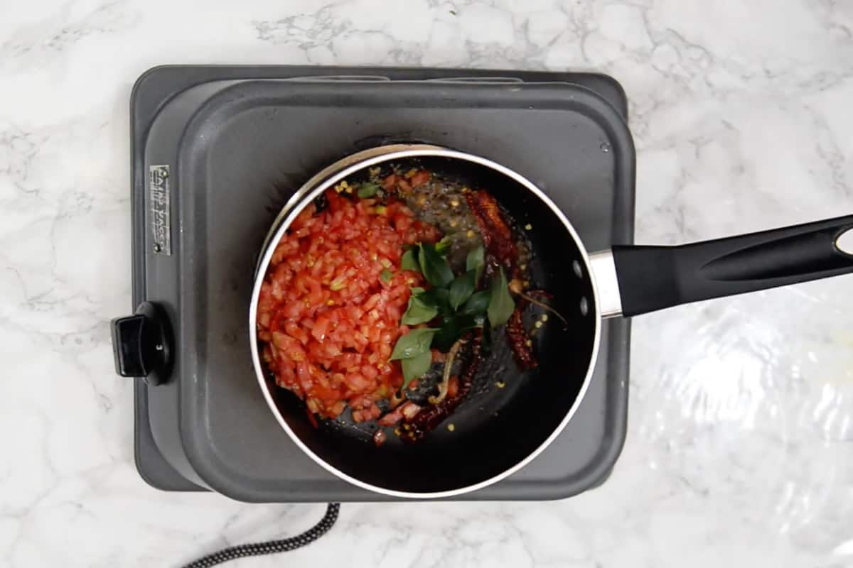 Tomato and curry leaves added in the pan.