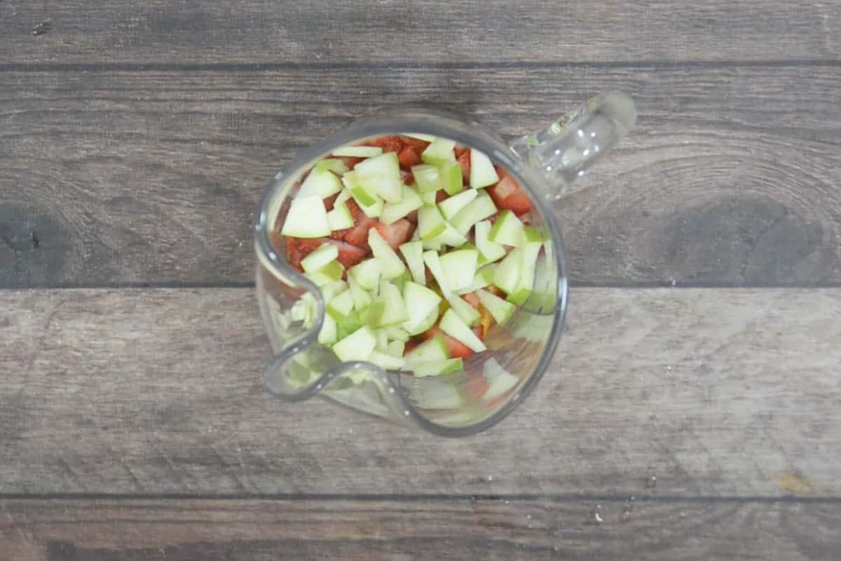 Fruits added to a pitcher.