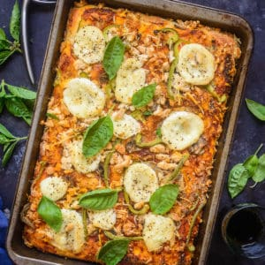 Sicilian Pizza or as traditionally called Sfincione, is a thick crust pizza topped with tomato, onion, breadcrumbs, and sometimes hard cheese. Here is how to make it.