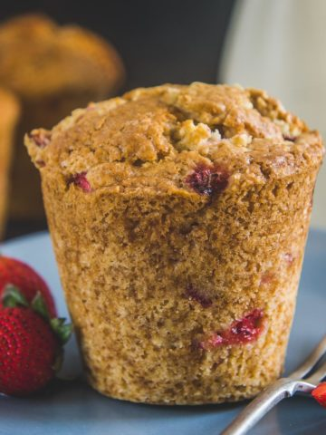Make the most of fresh strawberries by making these delicious homemade Strawberry Muffins. These bakery-style muffins are easy to make and have the perfect crumb.