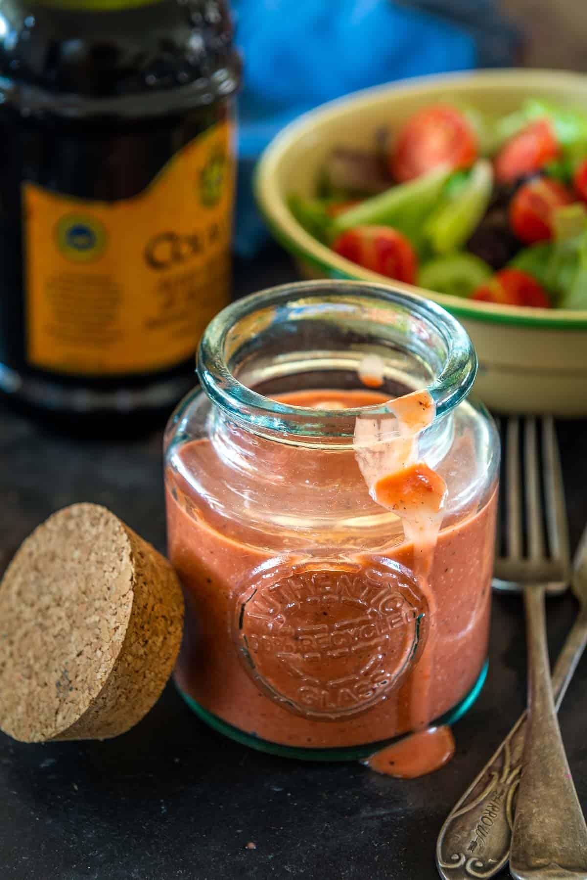 Strawberry vinaigrette served in a glass bottle.