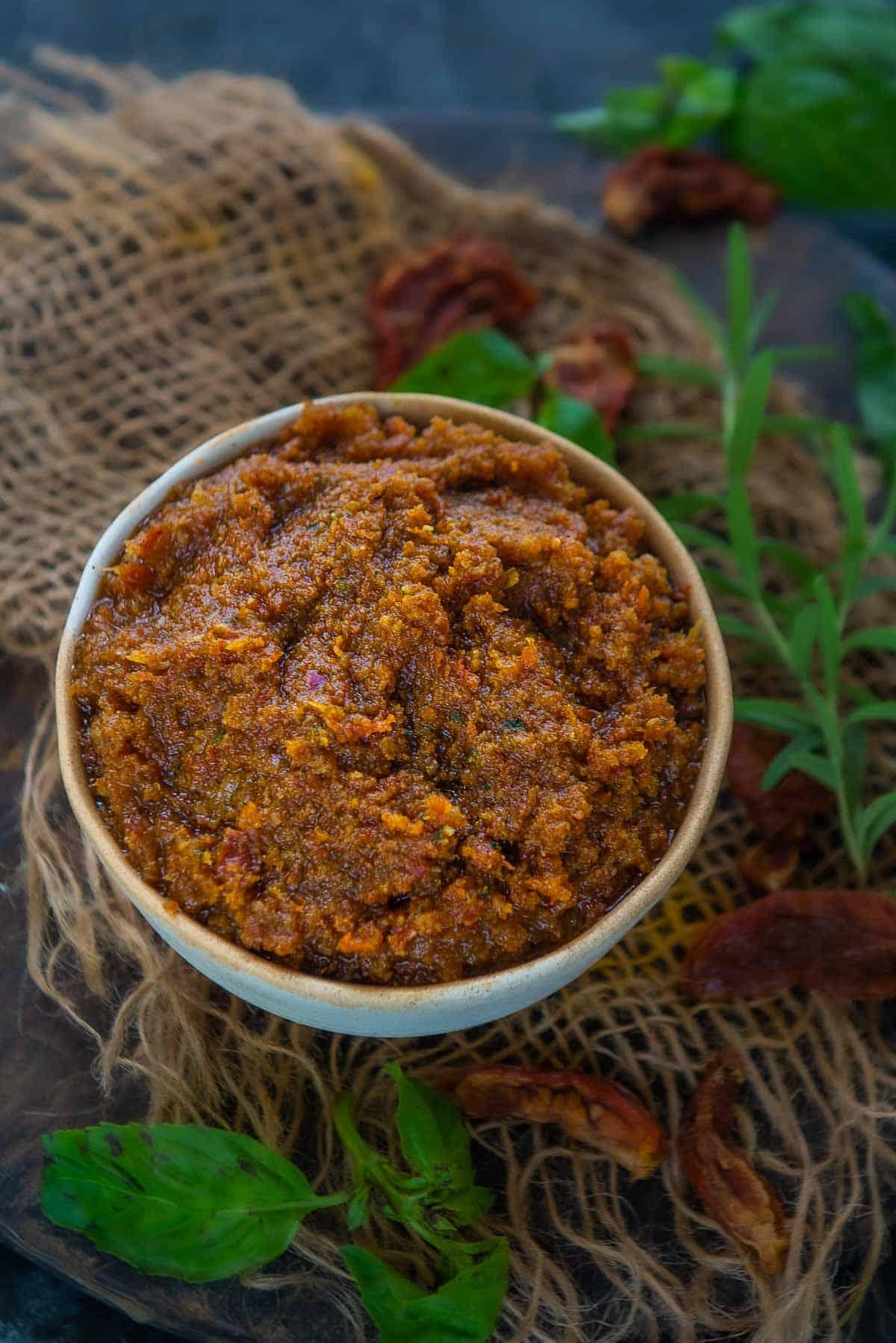 Sun Dried Tomato Pesto served in a bowl.