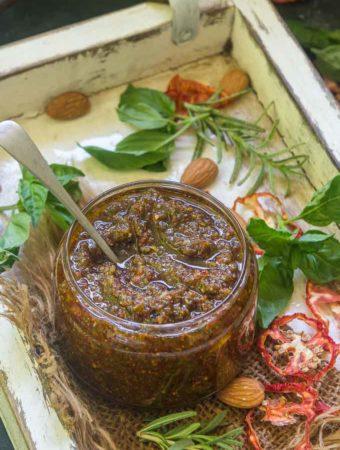 Sun Dried Tomato Pesto kept in a glass jar.