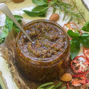 Sun-Dried Tomato Pesto, also known as Pesto Rosso, is full of goodness from sun-dried tomatoes, extra virgin olive oil and parmesan cheese. Made under 10 minutes, this sauce is gluten free too. Here is how to make Sun Dried Tomato Pesto Recipe.