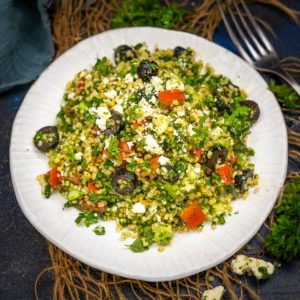 Tabouli Salad or Tabbouleh is a traditional Mediterranean/Middle Eastern Salad made using bulgar wheat, parsley, and vegetables tossed in a tangy lime juice dressing. It is refreshing, light, and full of flavors.