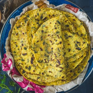 Methi Thepla is a very popular Gujarati dish made with flour, spices, and fresh fenugreek leaves. It is a soft flatbread that can be had at any time of the day. Here is how to make it at home.
