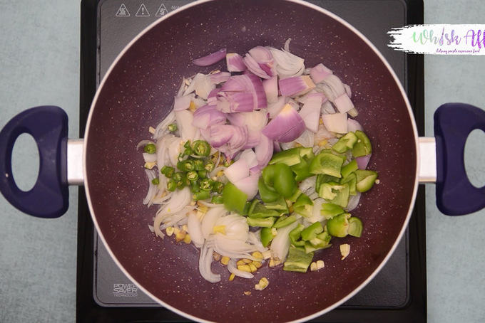 Green chilli, onion and capsicum added in the pan.