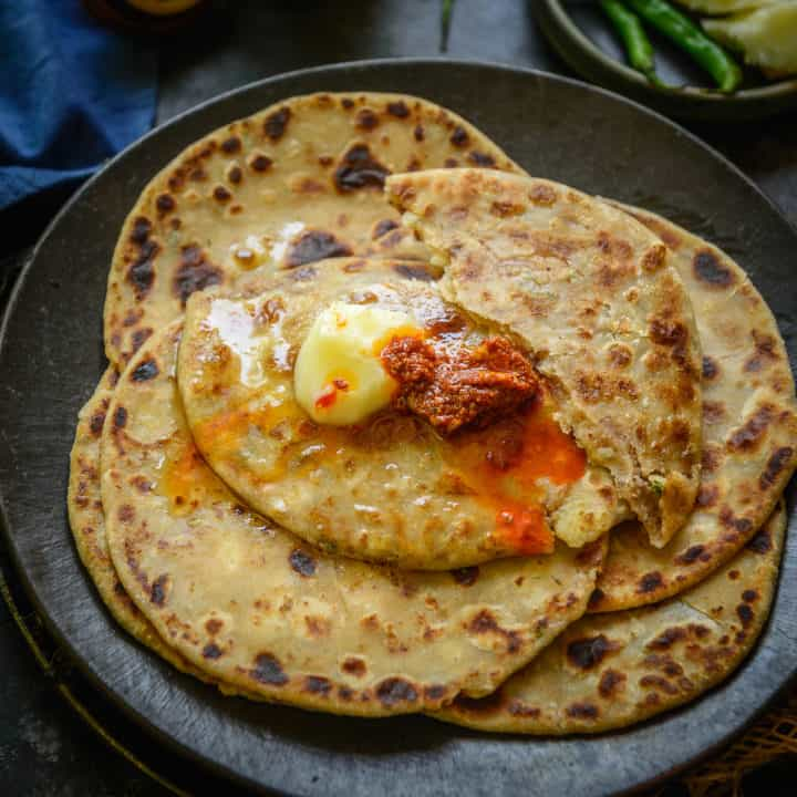 This Dhaba Style Aloo Paratha is a Punjabi stuffed flatbread made using whole wheat flour and a spicy potato filling. Serve it for breakfast, brunch, or any meal of the day, you are going to love it.