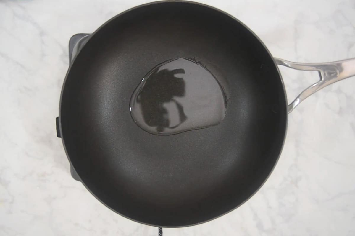 Oil heating in a wok.
