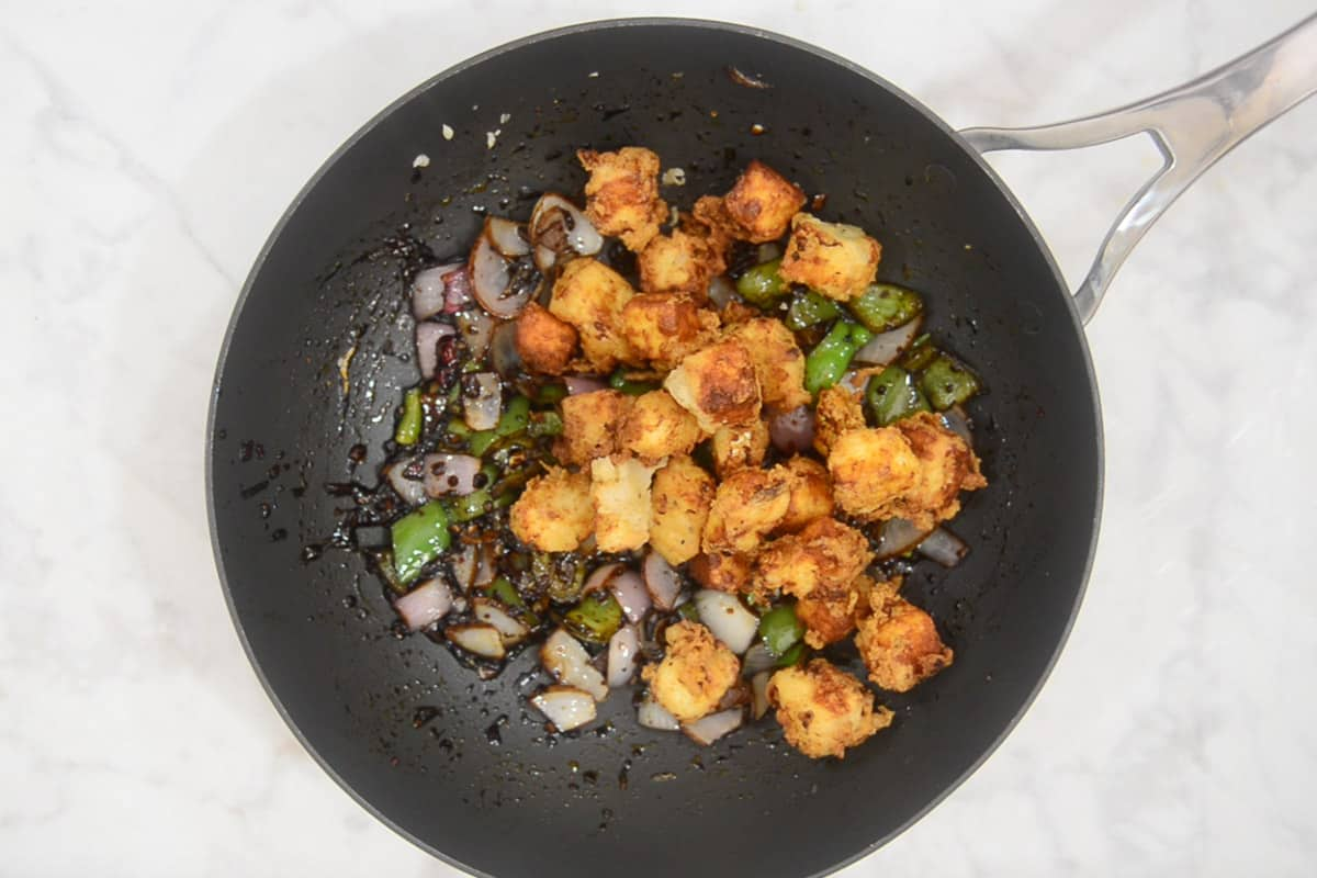 Cornflour slurry and paneer added in the wok.
