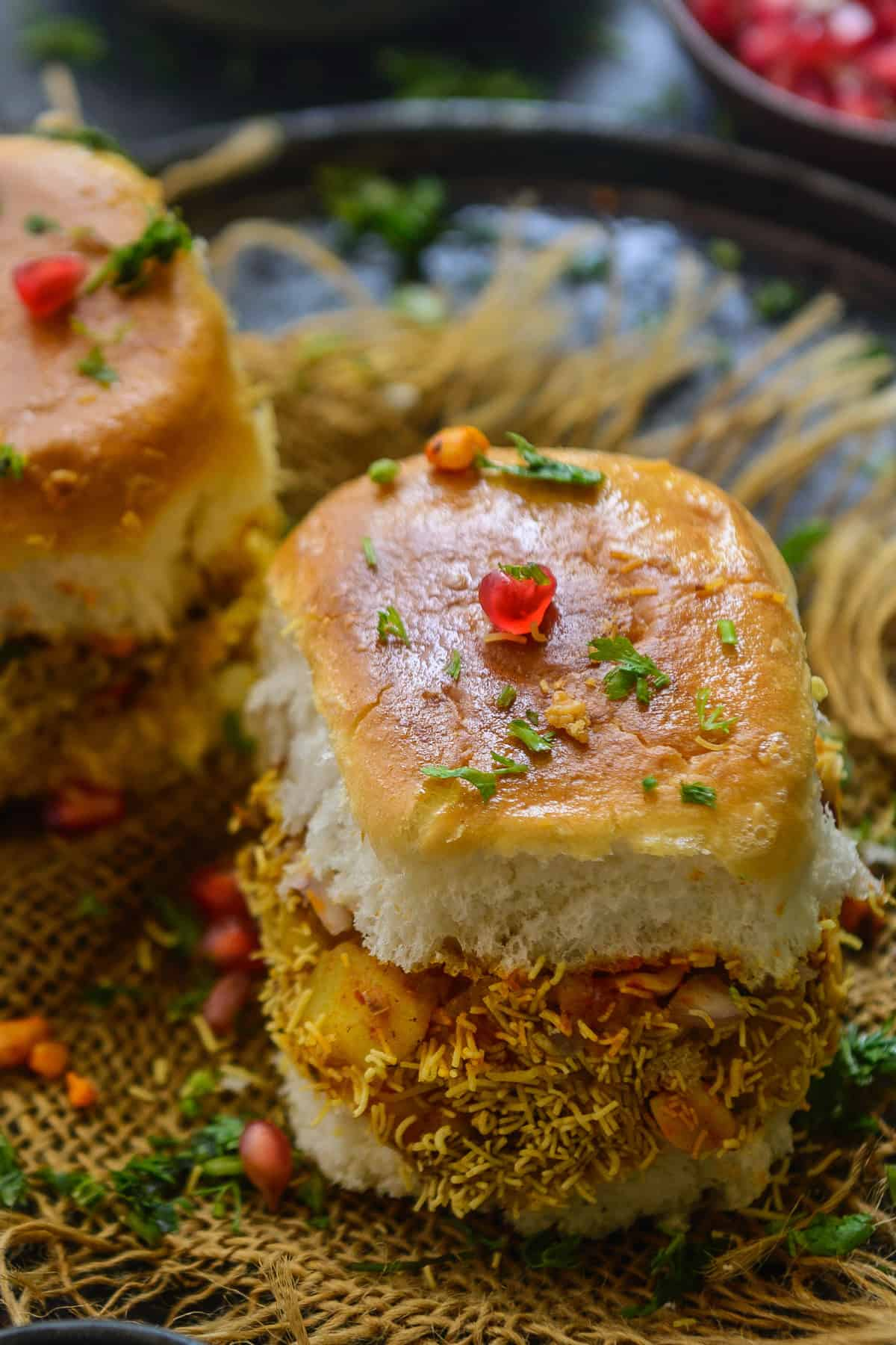 Dabeli served on a plate.