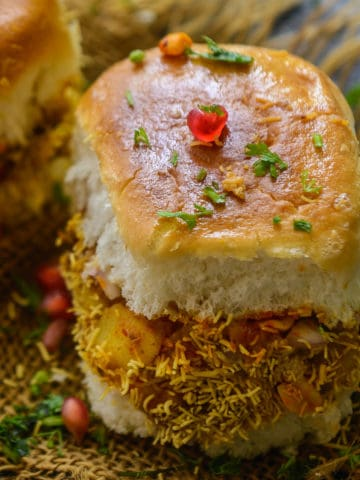Kutchi Dabeli is a popular Indian Street Food from the state of Gujarat and it's basically pav stuffed with tangy and spicy potato masala and chutneys. Here is how to make it at home.