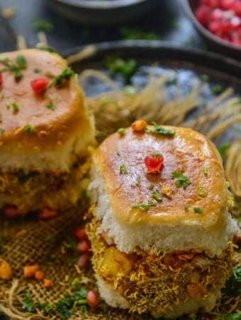 Kutchi dabeli served on a plate.
