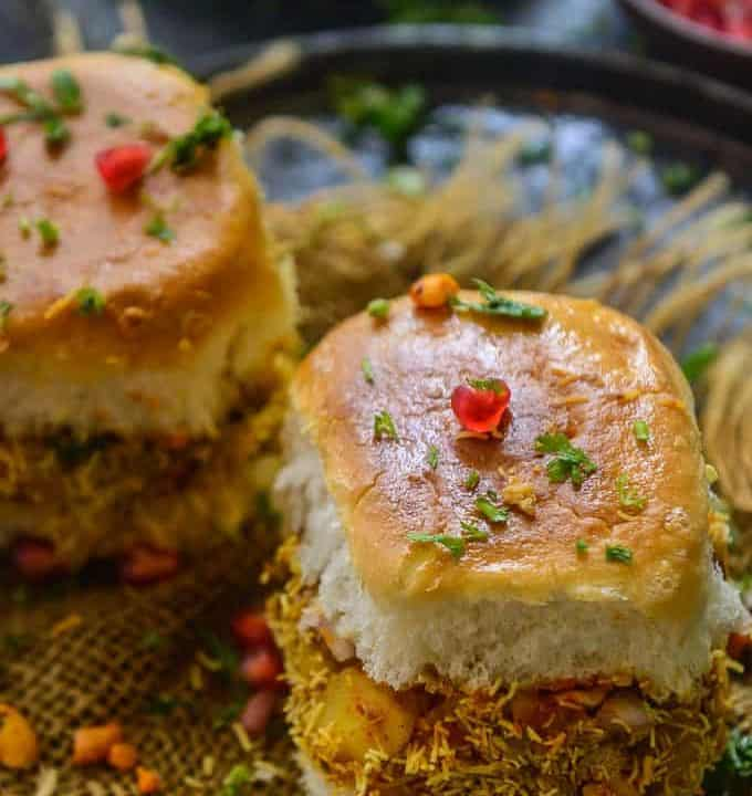 Kutchi dabeli served on a plate.