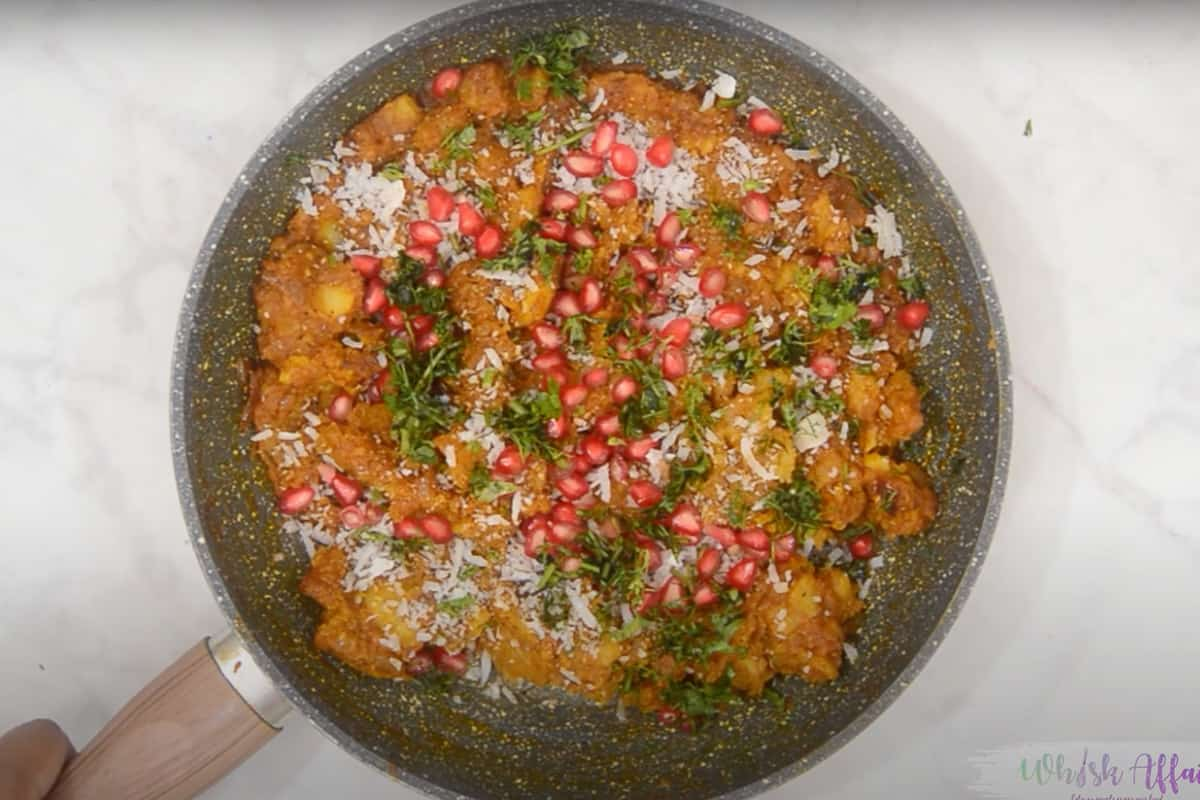 Stuffing topped with pomegranate, coconut and coriander.