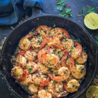 Garlic Butter Shrimp served in a pan.