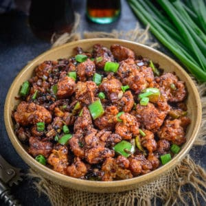 Gobi Manchurian is a popular Indo Chinese dish where crispy fried cauliflower florets are tossed in a spicy sauce. Make it dry and serve as an appetizer or make with gravy for the main course.
