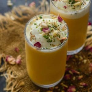 Mango Mastani is a popular Mango Drink sold in Pune. It's basically Mango milkshake topped with ice cream and dry fruits. Here is how to make Mango Mastani Recipe at home.