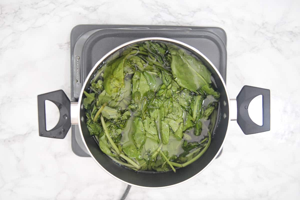 Spinach and baking soda added in boiling water.