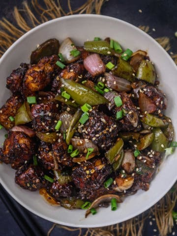 Chilli Paneer is a delicious Indo Chinese recipe where Paneer or Indian cottage cheese is coated with a batter and deep-fried until crisp. It is then tossed in a spicy sauce mixture.