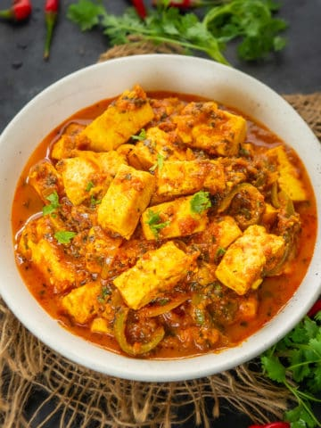 This restaurant-style Paneer Jalfrezi is a melange of Indian Cottage Cheese or Paneer and Vegetables in a spicy onion tomato sauce. Try it at home using my easy recipe.