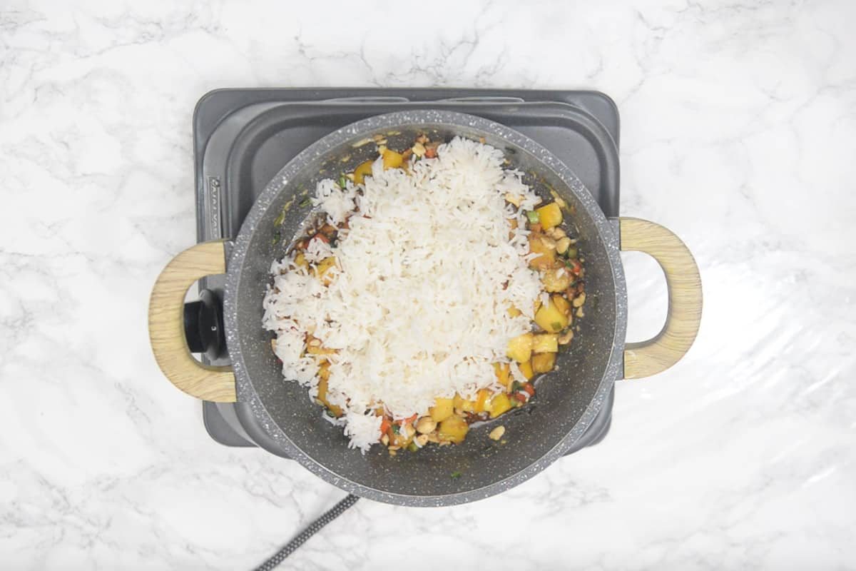 Cooked rice, sauces, lemon juice and salt added in the pan.