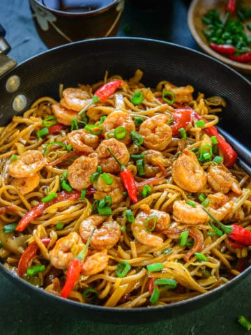 "Shrimp Chow Mein is a no pain, no fuss, easy one-pot meal that gets ready under 30 minutes. Take away? Say ""No!"" to them and enjoy this Cantonese style, Chow Mein, like a Boss at your home this weekend! Here is how to make it."