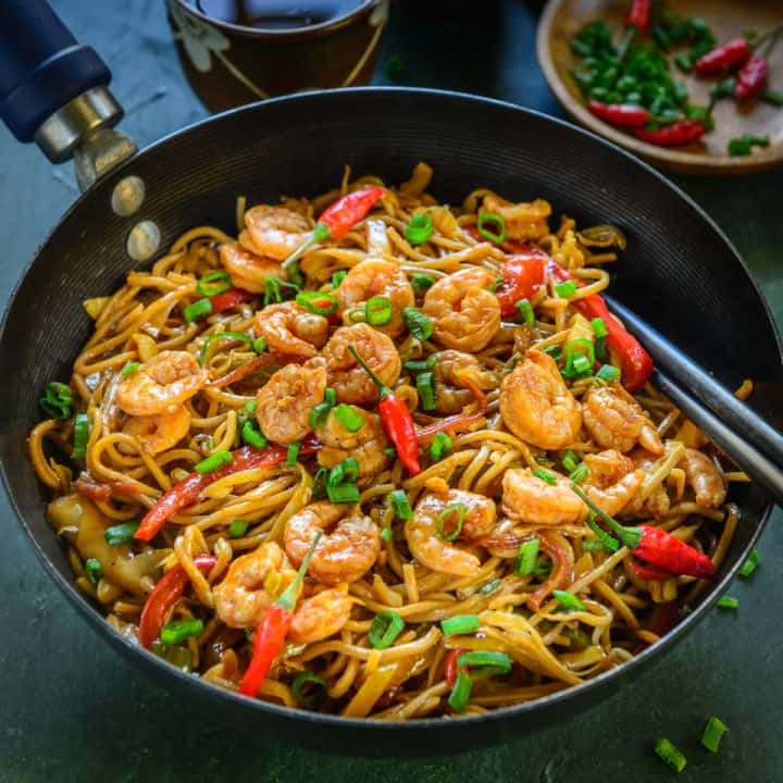 """Shrimp Chow Mein is a no pain, no fuss, easy one-pot meal that gets ready under 30 minutes. Take away? Say """"No!"""" to them and enjoy this Cantonese style, Chow Mein, like a Boss at your home this weekend! Here is how to make it."""