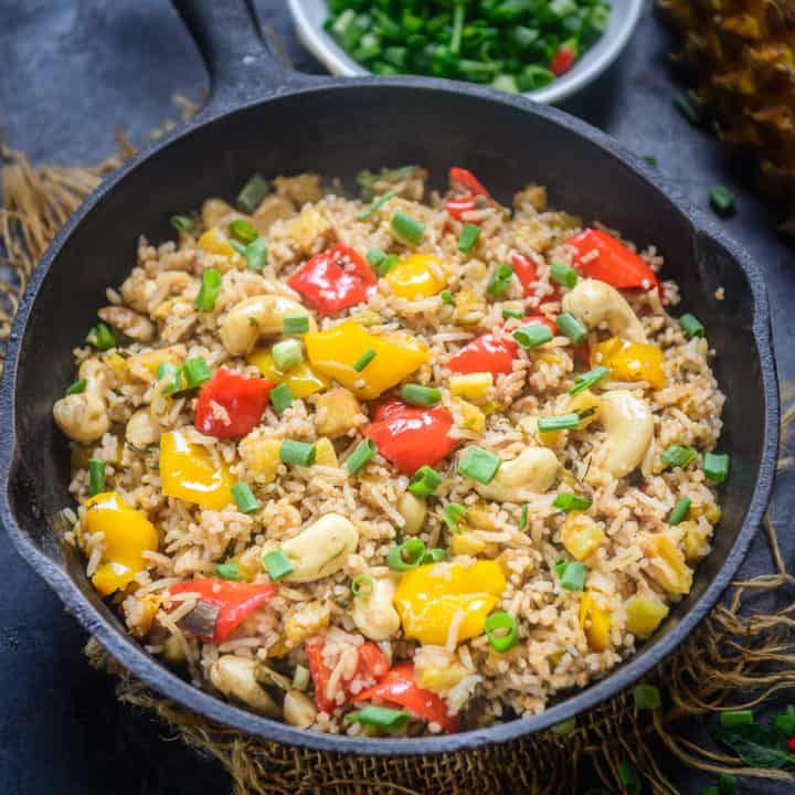This tangy and slightly sweet Thai Pineapple Fried Rice is a classic Thai recipe and a one-pot meal that can be put together in no time. Unlike the basic vegetable fried rice, the addition of pineapple slices, cooked in oyster sauce and lemon juice, adds a spicy-sweet tang that makes this dish irresistible.