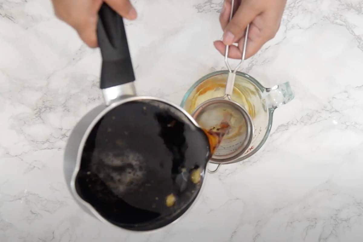 Tea straining using a strainer.