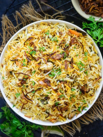 Hyderabadi Veg Biryani or Vegetable Biryani is a delicious medley of succulent vegetables, spices, ghee, saffron, and flavourful basmati rice which no one can resist. The best part is you can make a great restaurant-style version at home easily.