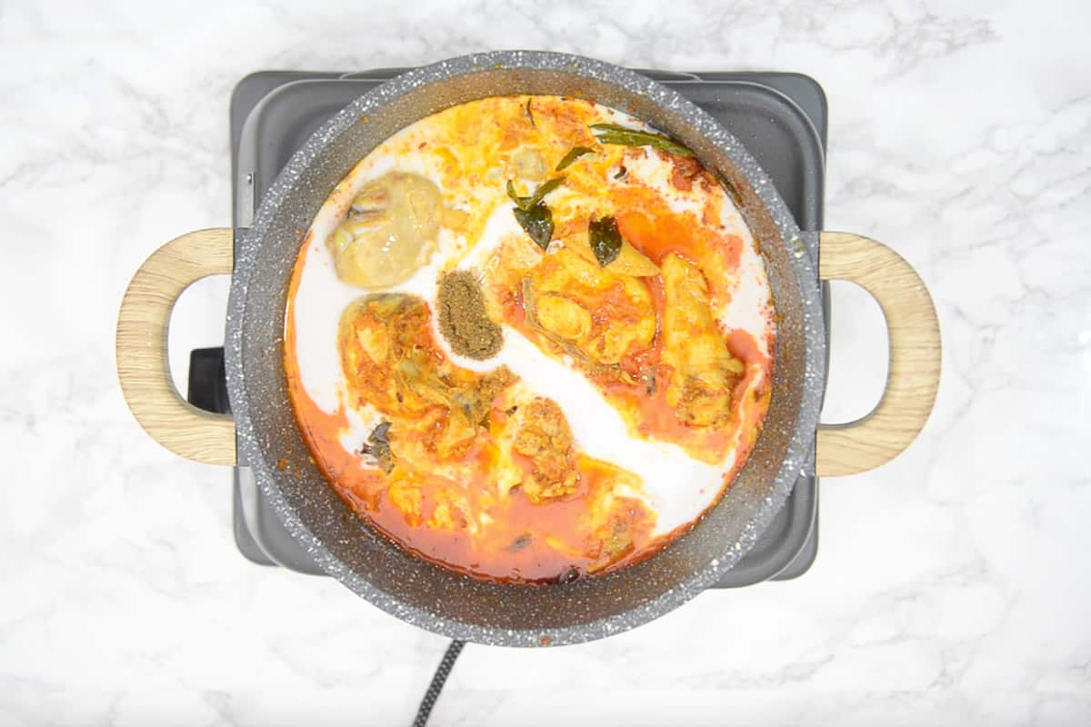 Garam masala and coconut milk added in the pan.
