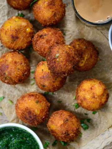 Make these super addictive Corn Cheese Balls for your next house party and see them disappear in seconds. These are easy to make, cheesy, crispy, freeze well, and taste amazing.