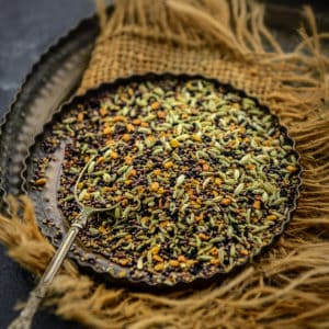 Made using 5 whole spices, Panch Phoran or Panch Phoron is a traditional spice mix that is quintessential in Bengali cuisine. It is very easy to make at home using five basic Indian spices. Here is how to make it.