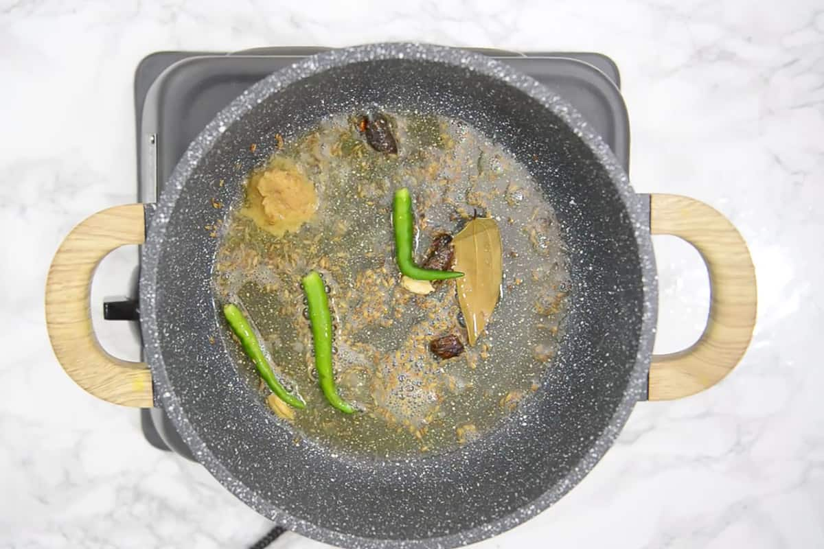 Green chillies and ginger garlic paste added in the pan.