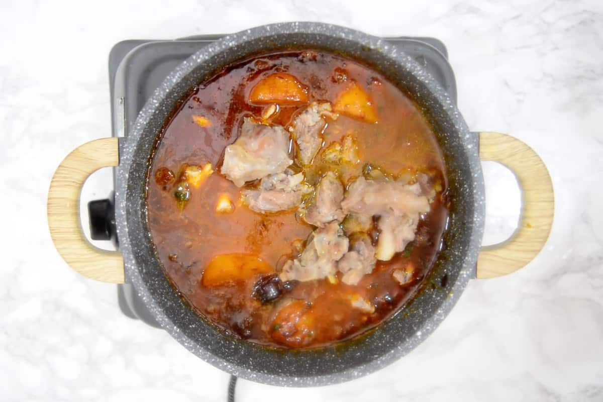 Cooked mutton added in the pan.