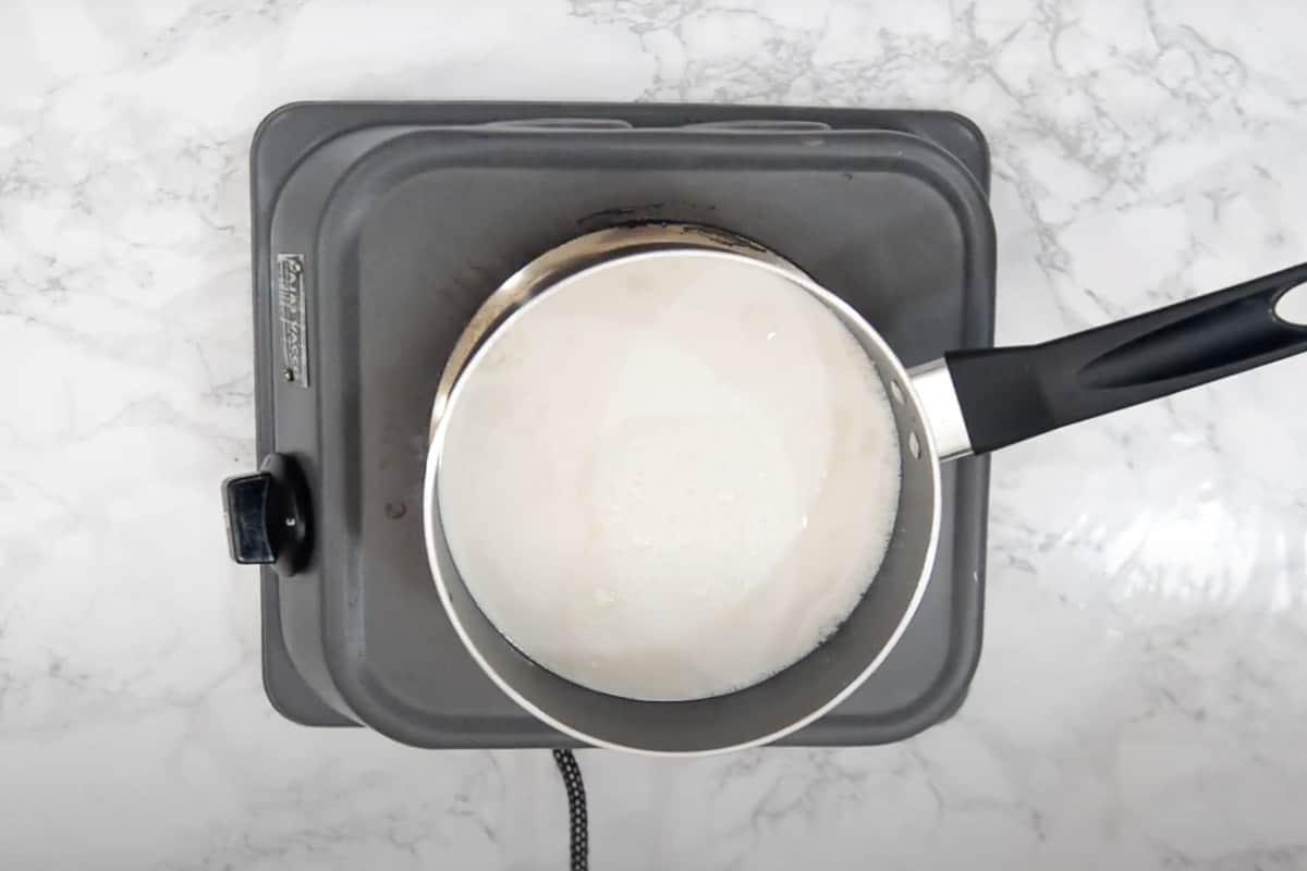 Milk boiling in a pan.