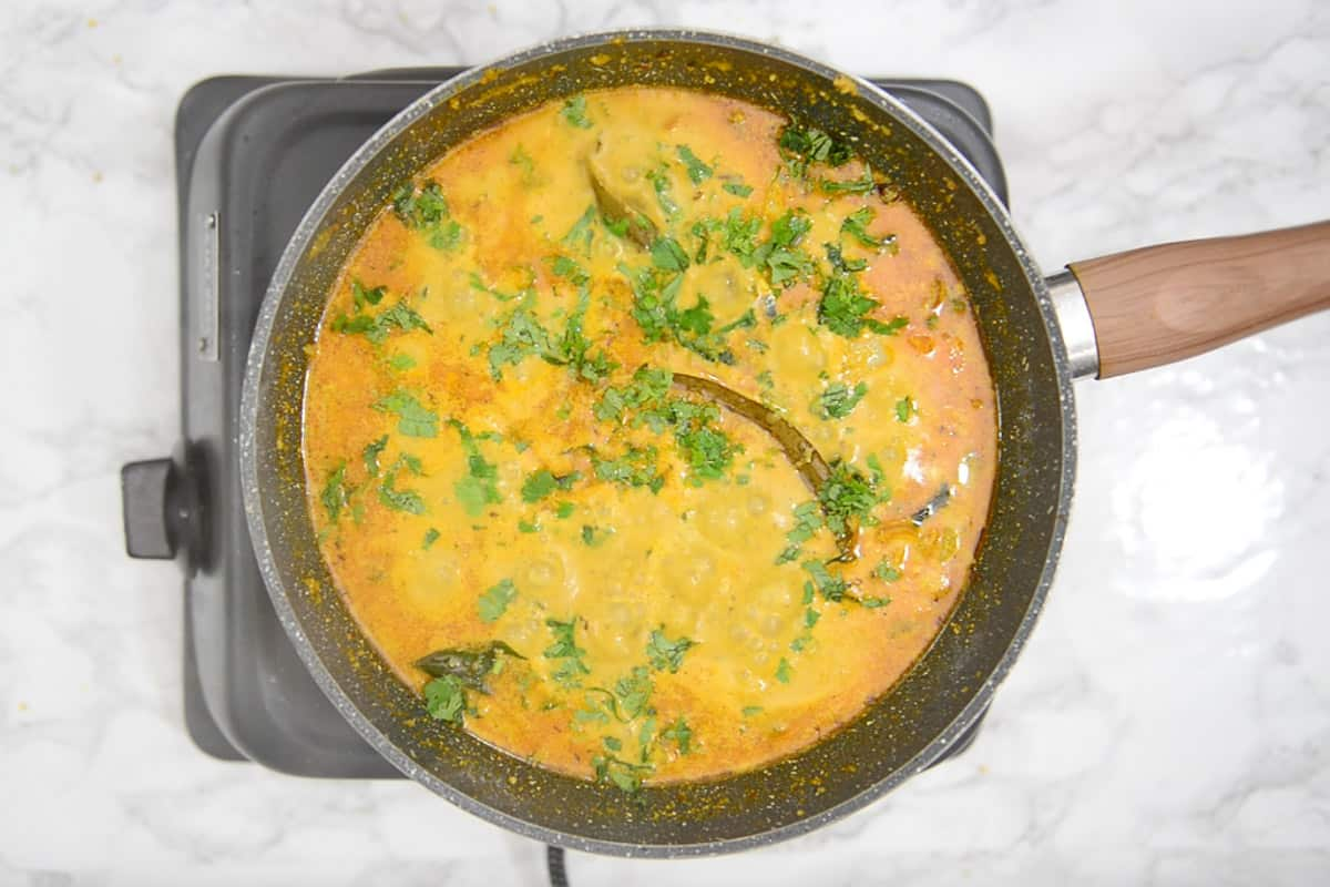 Ready veg kurma garnished with fresh coriander.