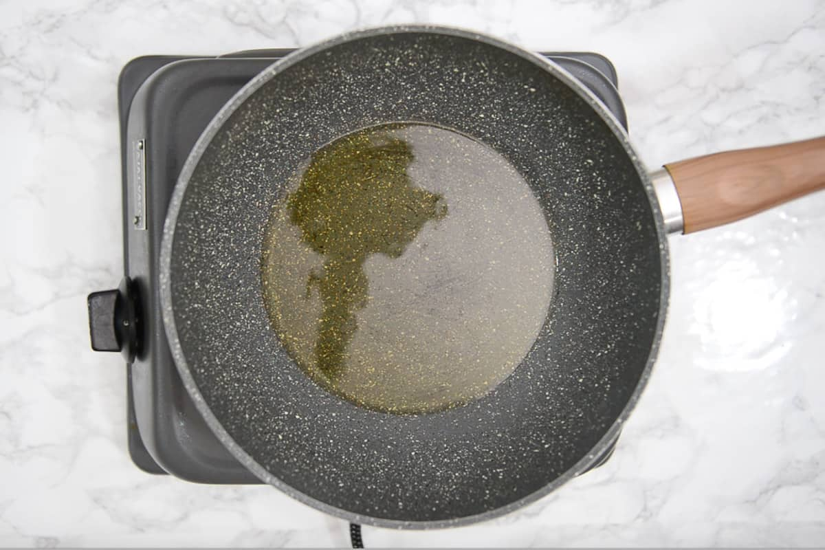 Vegetable oil heating in a pan.