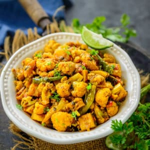 This Punjabi Aloo Gobi is a spicy Indian potato and cauliflower stir fry that is made for everyday meals. It is a vegan, gluten-free dish that can be enjoyed with any Indian style bread.