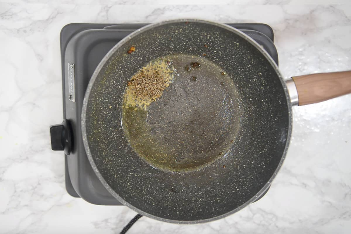 Cumin seeds added in remaining oil.