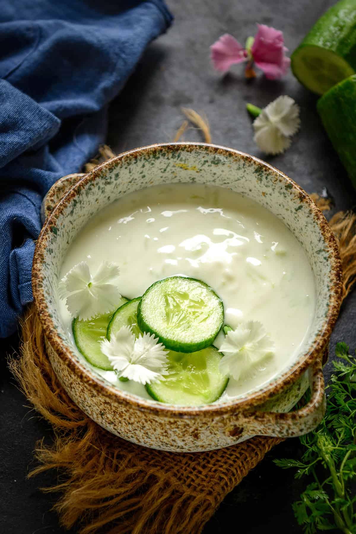 Cucumber Raita served in a bowl.