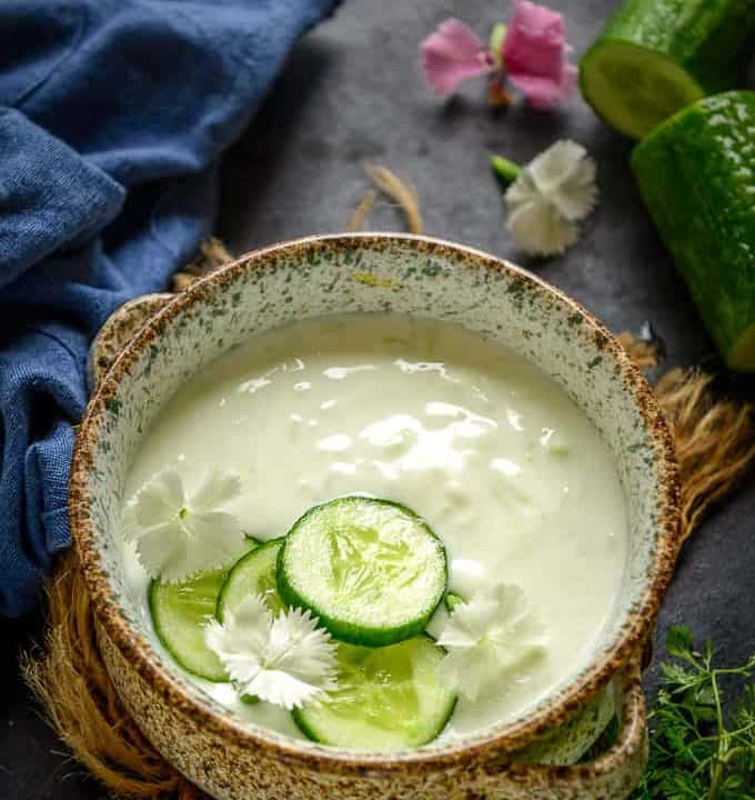 Cucumber Raita served in a bowl.