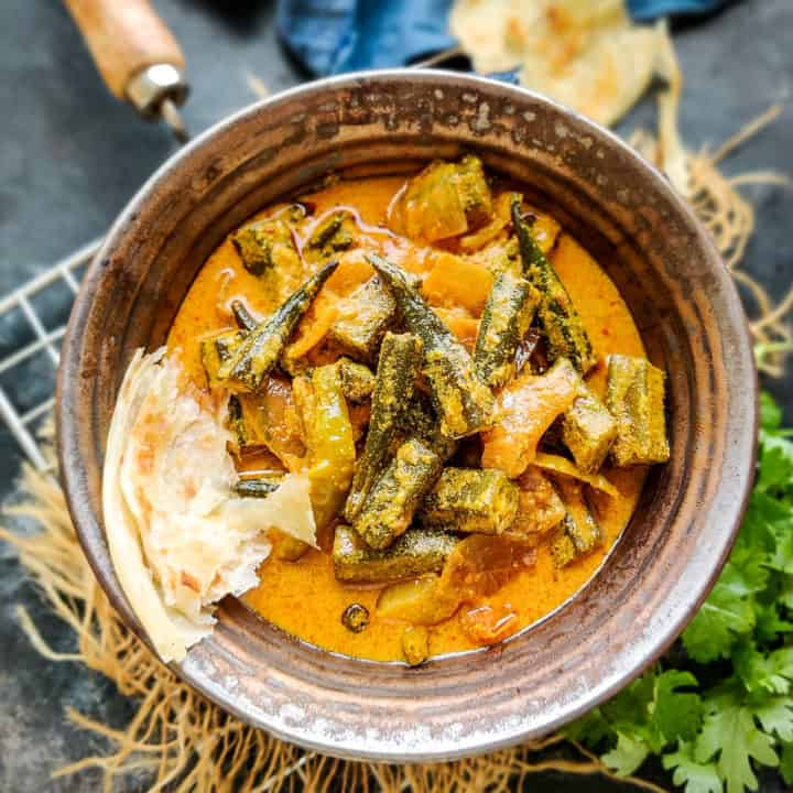 This delicious Dahi Bhindi is an Indian curry where Okra is cooked in a yogurt gravy. It is easy to make and goes well with any Indian bread. Here is how to make it.