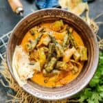 Dahi Bhindi is Okra cooked in a yogurt gravy. It is easy to make and goes well with any Indian bread. Here is how to make Dahi Bhindi Recipe.